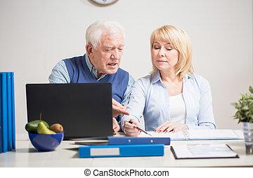 Elder people working together - Elder people developing new...