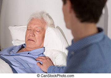 Elder sick man sleeping - View of an elder man falling ...