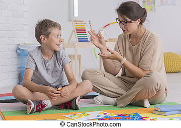 Elder sister teaching her brother