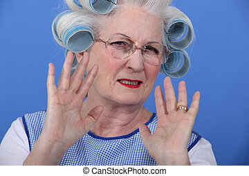 Elder upset with curlers in her hair