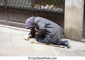 Elder woman homeless in the street