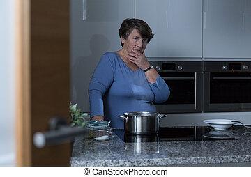 Elder woman in the kitchen