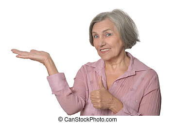 Elder woman pointing at copy space