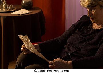 Elder woman reading a letter - Elder woman calling old times...