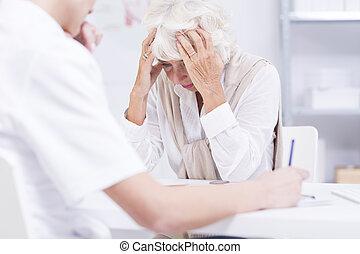 Elder woman sitting in a doctor's office