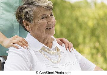 Elder woman sitting on a wheelchair