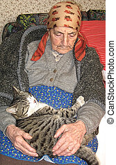 elder woman sleeping with a cat