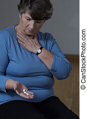 Elder woman taking medicine