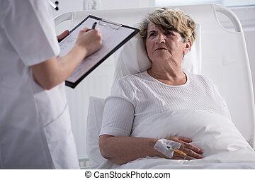 Elder woman talking to doctor