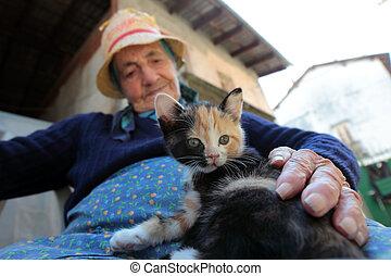 elder woman with kitten