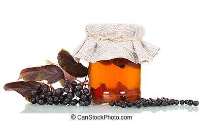 Elderberry and drink of rose hips isolated on white ...