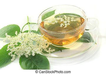 Elderflower tea - a cup of elderflower tea with a sprig of...