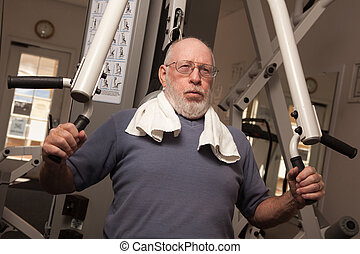 Elderly Adult Man Working Out in the Gym.