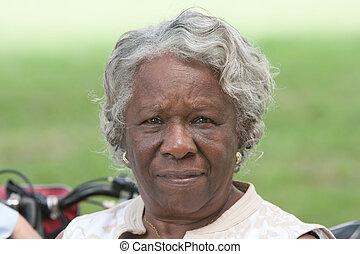 Elderly african american lady outside