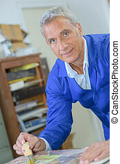 Elderly artist at work