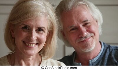 Elderly attractive couple retired family smiling looking at camera