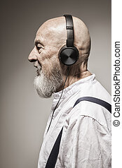elderly bald head man with headphones