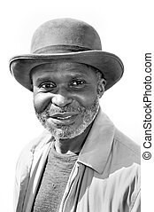 Elderly black man smiling - An elderly black man with a ...