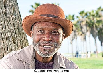 Elderly black man smiling - An elderly black man with a...