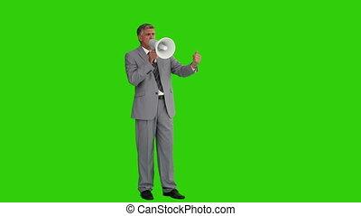 Elderly businessman giving orders through a megaphone