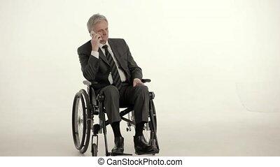 Elderly businessman in wheelchair