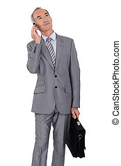 elderly businessman on white background