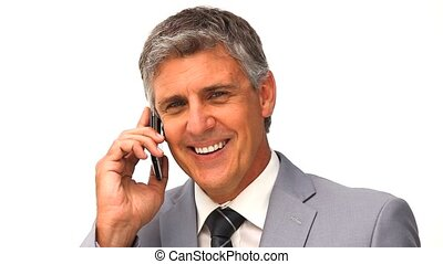 Elderly businessman speaking on a smartphone isolated on a white background