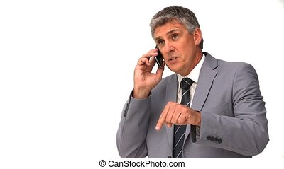 Elderly businessman talking on a smartphone