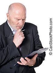 Elderly businessman with clipboard on white background