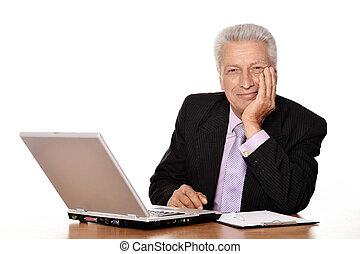 Elderly businessman with laptop