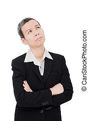 Elderly businesswoman thinking over white background