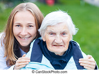 Portrait of elderly woman and her caregiver