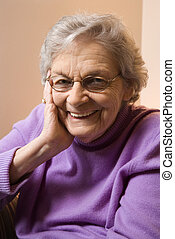 Elderly Caucasian woman smiling.