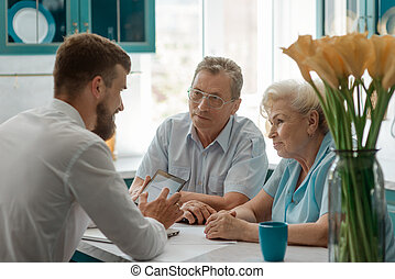 Elderly clients consulting an advisor. Retirement and financial planning