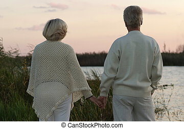 Elderly couple at night river