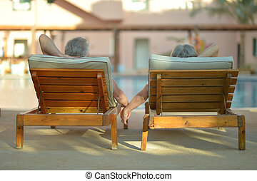 Elderly couple at pool