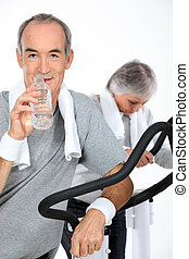 Elderly couple at the gym
