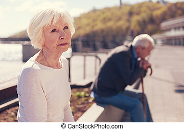 Elderly couple being absorbed into unsettling thoughts