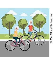 Elderly couple cycling.