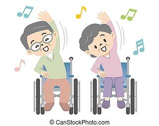 Elderly couple doing gymnastics in a wheelchair