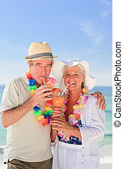 Elderly couple drinking a cocktail
