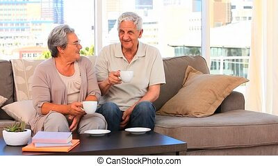 Elderly couple drinking a cup of te