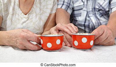 Elderly couple drinking tea
