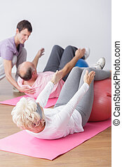 Elderly couple during training