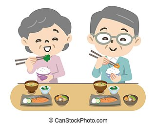 Elderly couple eating with a smile