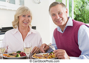 Elderly Couple Enjoying meal, mealtime Together