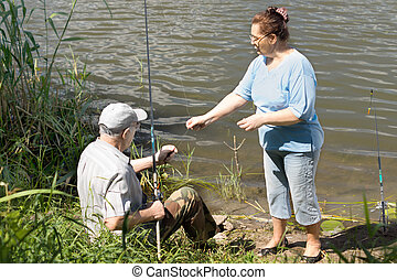 Elderly couple fishing on a freshwater lake