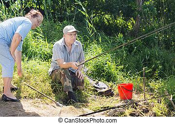 Elderly couple fishing together