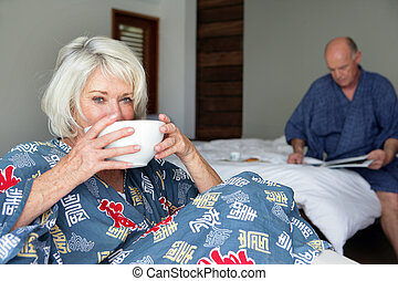 Elderly couple getting-up