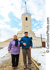 Elderly couple going to the church